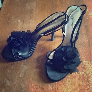 Black sandal heels with flower accent